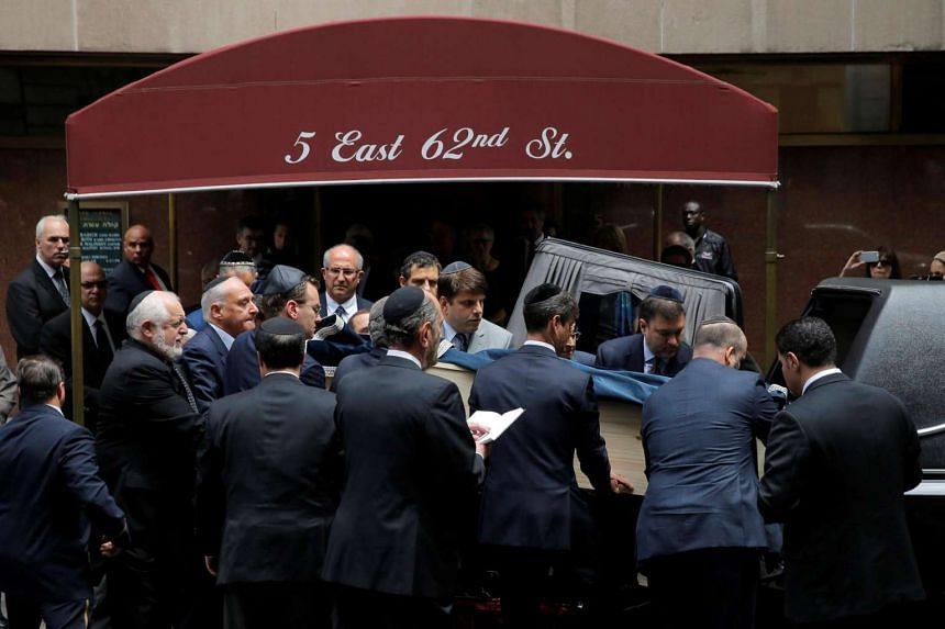 The coffin of Nobel Peace Prize winner Elie Wiesel is carried out following his memorial service at the Fifth Avenue Synagogue in Manhattan, New York, July 3, 2016.
