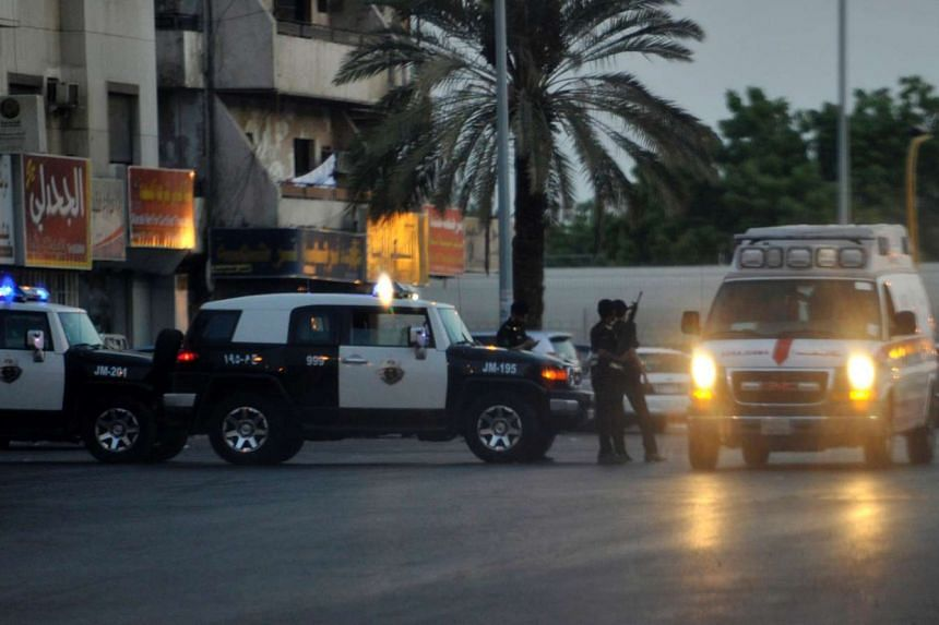 Saudi police stand guard at the site where a suicide bomber blew himself up near the American consulate in Jeddah.