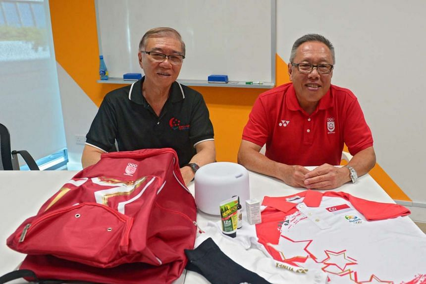 "Mr Ho Cheng Kwee (left) and Mr Low Teo Ping, Olympics and Paralympics chefs de Mission, with the ""bag of tricks"" for the athletes competing in the Rio Games."