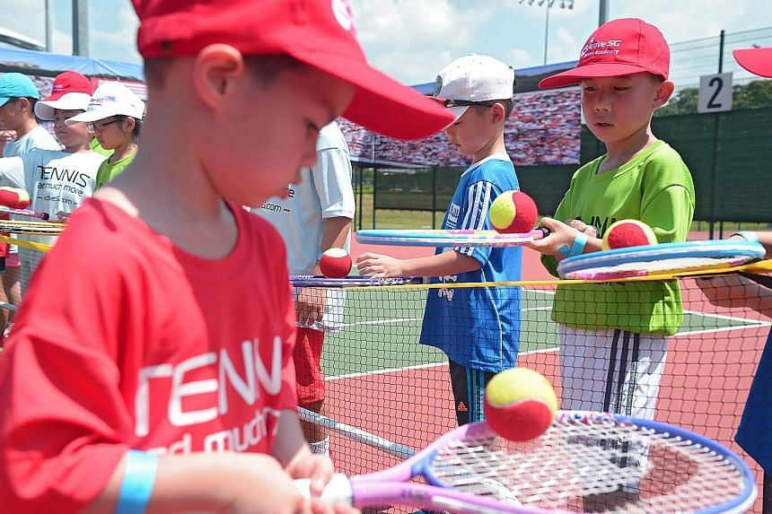 Children learning mini tennis at the launch of the ActiveSG tennis academy at the Kallang Tennis Centre yesterday.