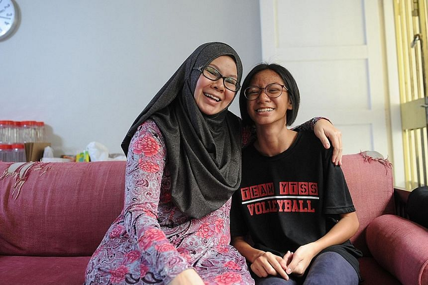 Amanda, a beneficiary of The Straits Times School Pocket Money Fund, credits mum Juliana for inspiring her to do well in the PSLE.