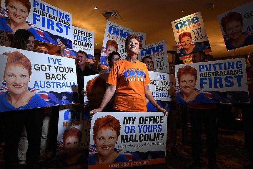 Ms Hanson with supporters at a function on election night in the city of Ipswich, Australia, on Saturday. She has largely shifted her focus from attacking Asian migrants to criticising Islam. But she wants to restrict overall migration.