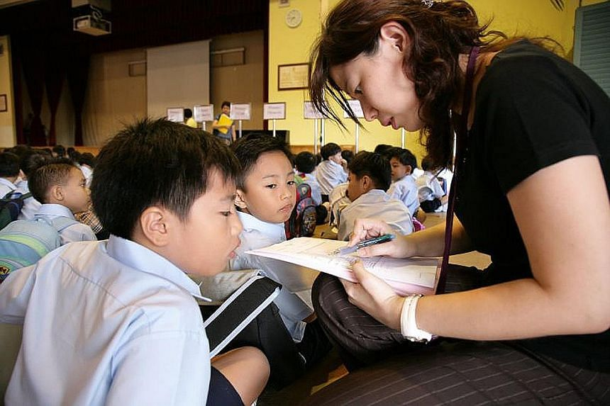 Mrs Koe, chairman of Ngee Ann Primary School's Parent Support Group, with pupils of the school. Volunteers can contribute in different ways, playing their part and balancing it with other commitments.