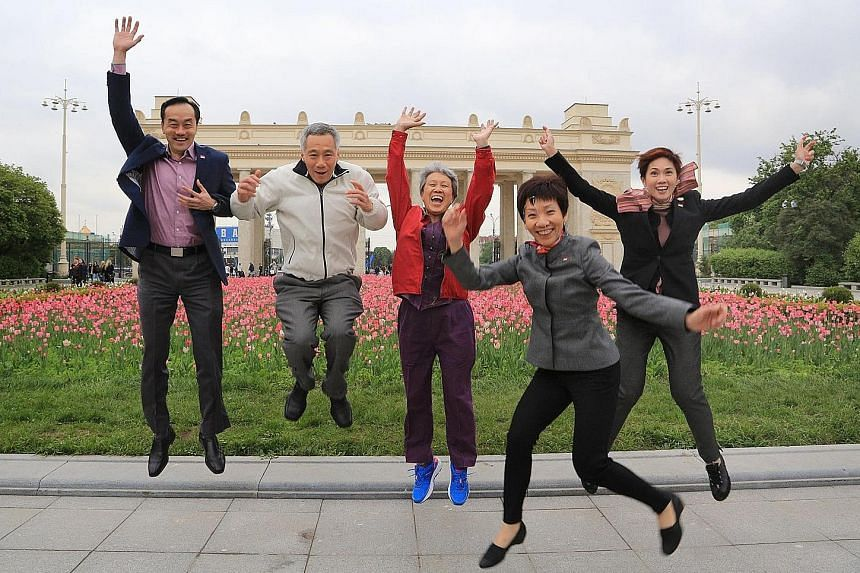 From left: Dr Koh, PM Lee, Mrs Lee, Ms Fu and Mrs Teo in the jump shot taken in Moscow in May. PM Lee posted it on his Facebook page yesterday to mark Youth Day.