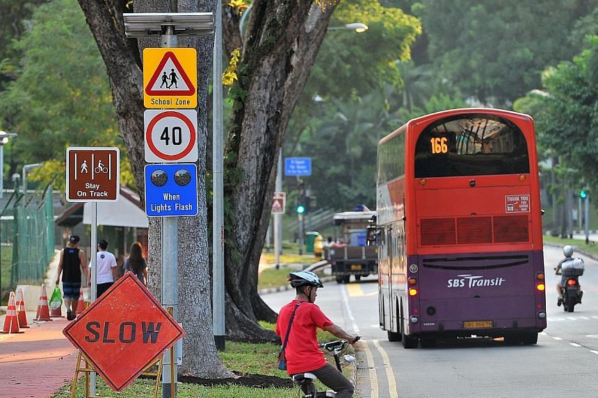 A speed limit sign outside Ang Mo Kio Primary School. A pilot programme involving 10 schools launched in January last year, as part of the enhanced school zone scheme, was found to be effective. More than 170 of the 187 primary schools islandwide wil