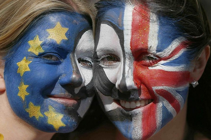 Anti-Brexit protesters with painted faces during the March For Europe demonstration in central London on Saturday.