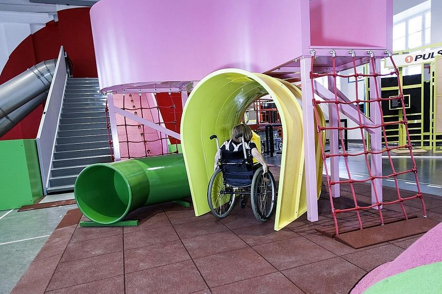 A young wheelchair user taking part in an obstacle course at the MegaMind science centre in Sweden's National Museum of Science and Technology.