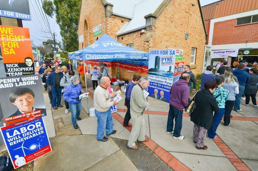 Voters line outside a polling booth in Adelaide's suburb of Glynde, South Australia, Australia, on July 2.