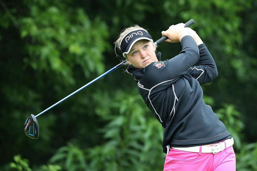 Brooke Henderson hits her tee shot on the 9th hole during the first round of the Meijer LPGA Classic on June 16 at the Blythefield Country Club in Belmont, Michigan.