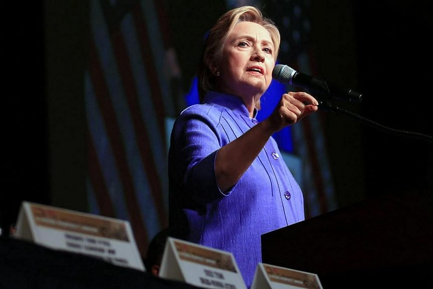 Hillary Clinton delivering a keynote speech at the International Women's Luncheon at the 50th Rainbow PUSH Coalition convention.