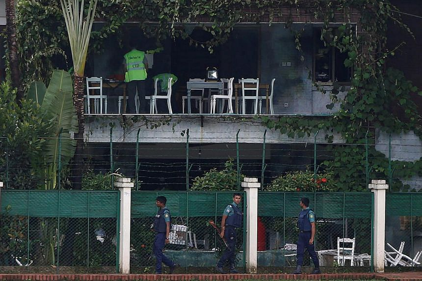 Policemen patrol outside the Holey Artisan Bakery and the O'Kitchen Restaurant in Dhaka, Bangladesh, on July 3, 2016.