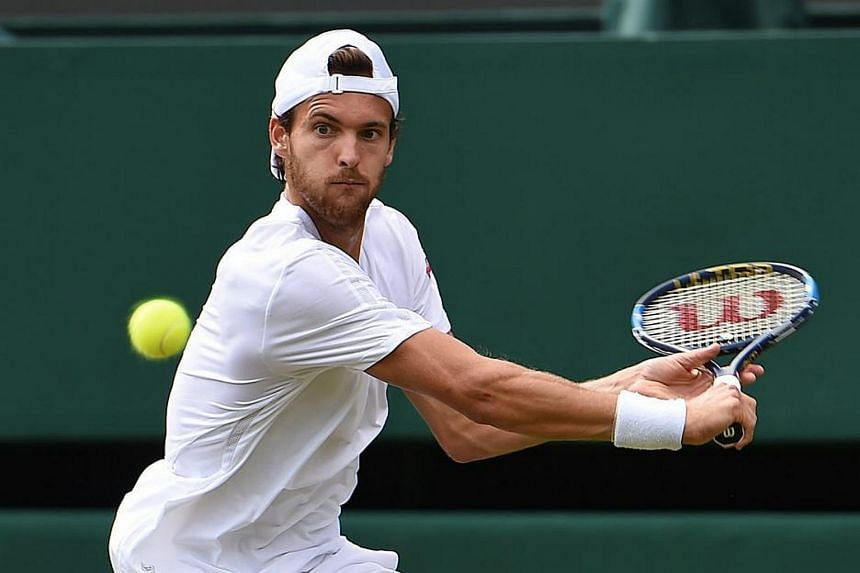 Joao Sousa of Portugal returns to Jiri Vesely of Czech Republic during their third round match of the Wimbledon Championships on July 3.