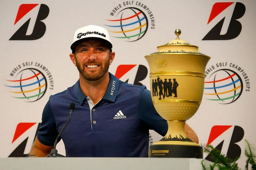 Dustin Johnson speaks to the media with the Gary Player Cup after winning the World Golf Championships - Bridgestone Invitational on July 3.