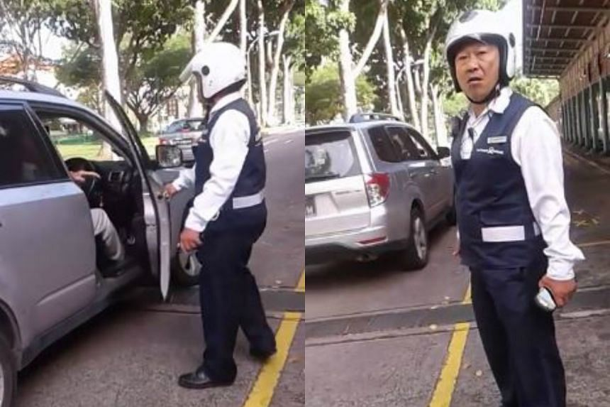 The LTA enforcement officer was seen arguing with the car driver before he yanked open the car door.