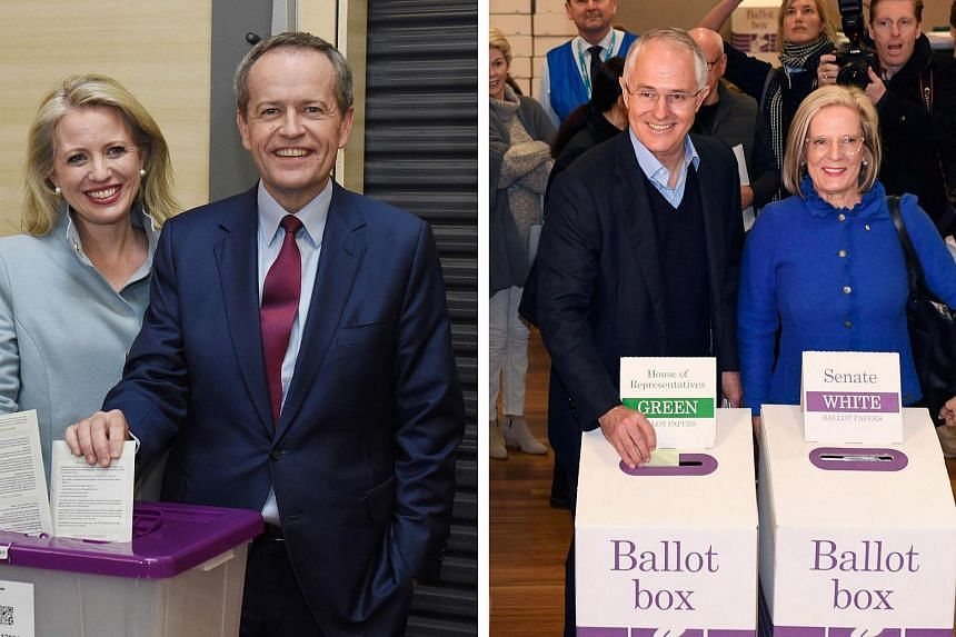 Opposition Labor Party leader Bill Shorten with his wife Chloe (left) voting in Melbourne, and Australia's PM Malcolm Turnbull voting with his wife Lucy in Sydney on July 2.