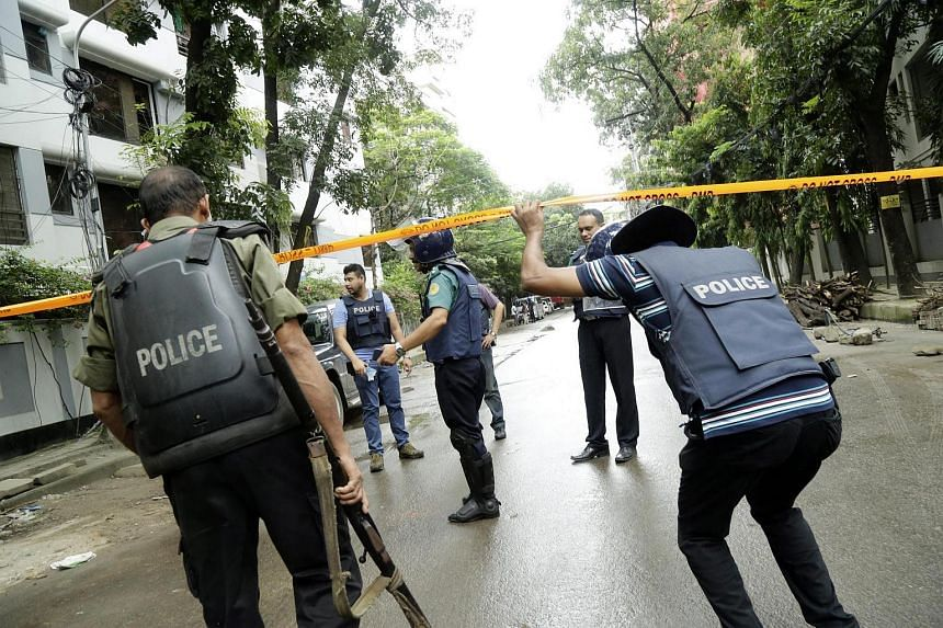 Policemen guard the streets close to the Holey Artisan Bakery in Dhaka.