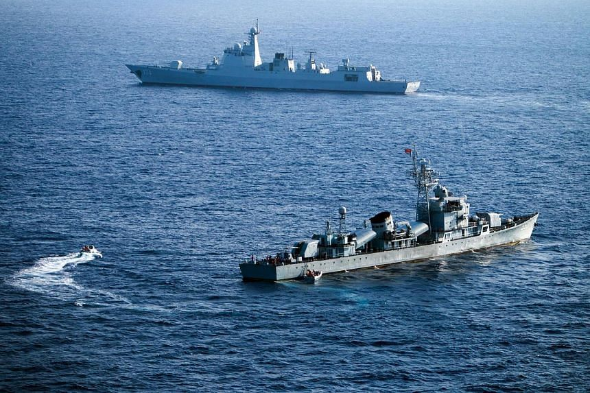 Crew members of China's South Sea Fleet taking part in a drill in the Paracel Islands in the South China Sea on May 5.