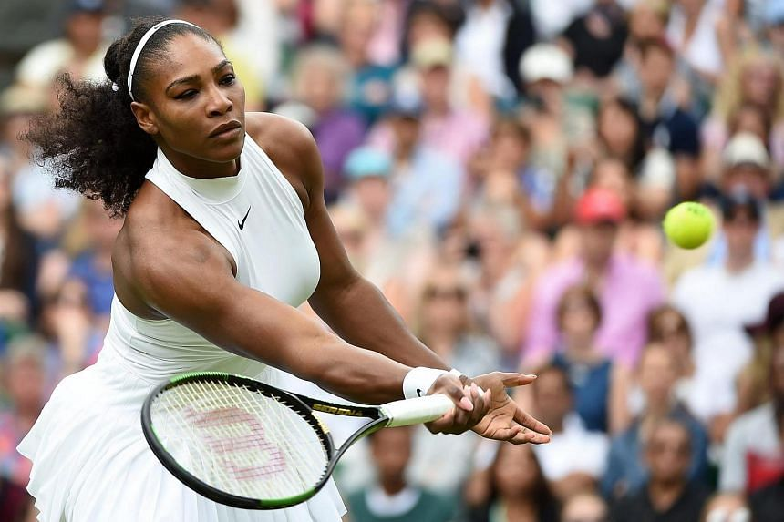 Serena Williams returns to Annika Beck during their third round match at the Wimbledon Championships.