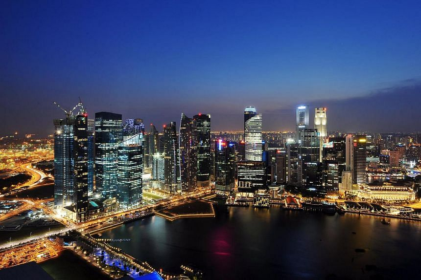 A skyline night view of the Singapore Central Business District.