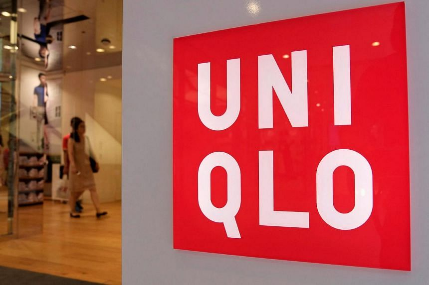 Shoppers walk inside Japan's Fast Retailing Co's Uniqlo casual clothing store in Tokyo, Japan, in 2014.