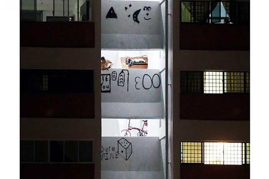 Residents of Block 9, Marsiling Drive, found parts of the block's facade marked with drawings of things like a traffic light on June 14, 2016.