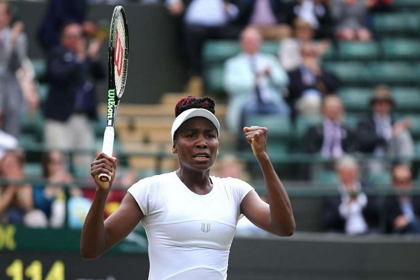 Venus Williams celebrates beating Yaroslava Shvedova in their women's singles quarter-final match at the 2016 Wimbledon Championships, on July 5, 2016.