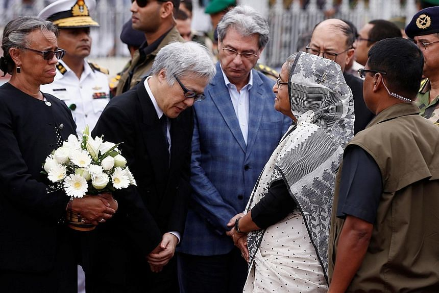 Prime Minister Sheikh Hasina talks to Japan's Ambassador to Bangladesh Masato Watanabe after paying homage to those killed. Among the victims were seven Japanese. Relatives carrying the coffin of one of those killed in last Friday's cafe attack in Dh