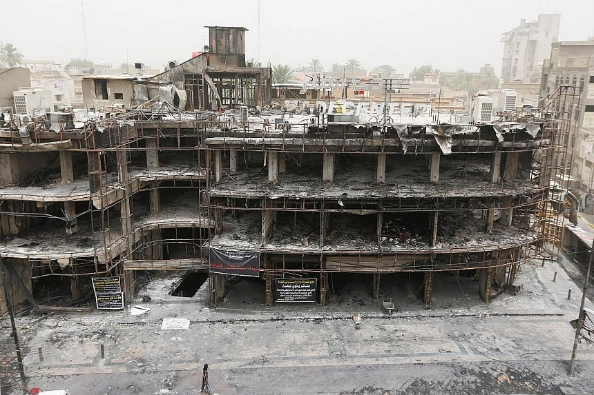 The site of a suicide bomb attack in the shopping area of Karrada in Baghdad on Sunday which killed at least 213 people, one of three major attacks linked to ISIS in the past week. It follows a deadly cafe siege last Friday in Dhaka in which 20 hosta