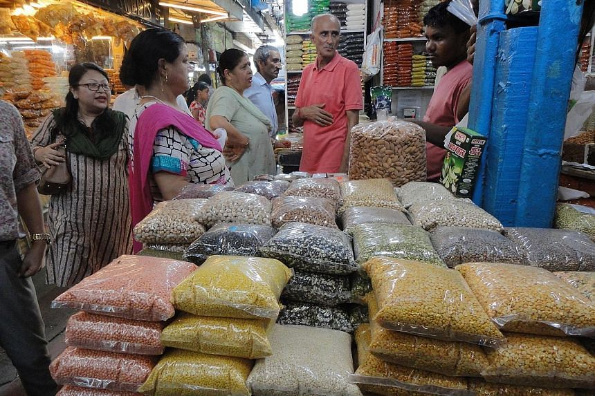 At INA market, a food bazaar in Delhi, the sale of lentils in some of the shops has been slow in recent weeks.