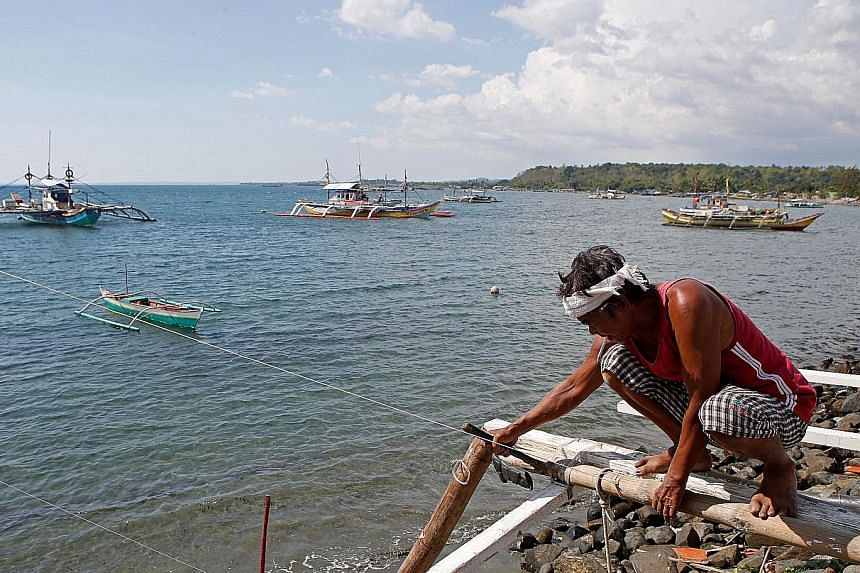 Boats that fish in the South China Sea's disputed Scarborough Shoal anchored off Masinloc in the Philippine province of Zambales. Manila is contesting Beijing's claims to most of the South China Sea, through which $6.7 trillion in ship-borne trade pa