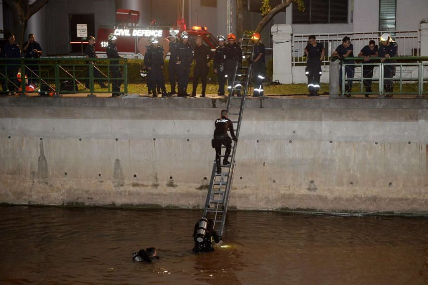 Rescue workers from SCDF searching the Alexandra Canal after the Mercedes Benz driven by Madam Yep Lay Choo plunged into the waters.