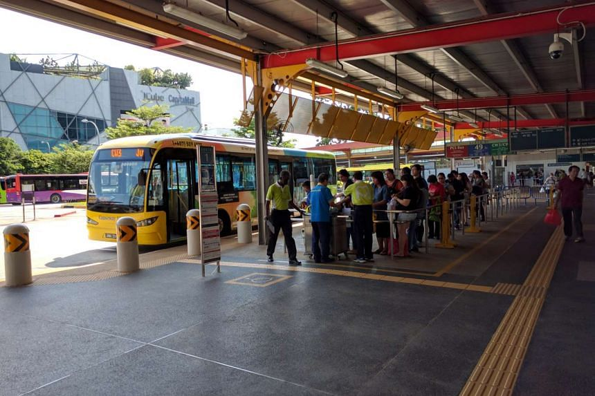 Commuters waiting to board the CW3 bus to Taman Bukit Indah, Johor at Jurong East Regional Interchange, on July 5, 2016.