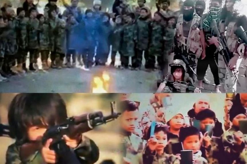 Screengrabs from the Islamic State video purportedly showing a child soldier and Malaysian passports being burned.