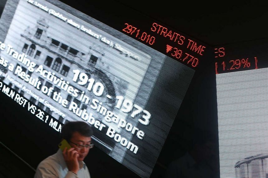 A ticker board in the SGX Centre displaying the Straits Times Index (STI) after the market closed on August 21, 2015.