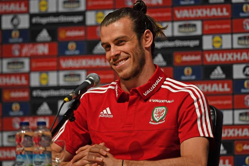 Wales' forward Gareth Bale gives a press conference in Dinard, on July 4, 2016, two days ahead of the team's Euro 2016 semi-final football match against Portugal.