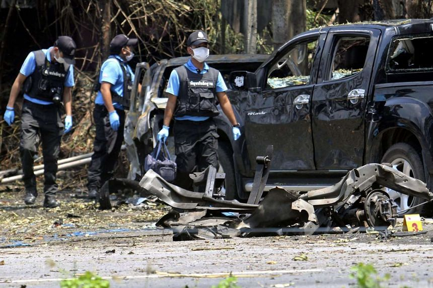 Police officers inspecting the site of a bomb blast at a checkpoint in Pattani province, southern Thailand, on July 5, 2016.