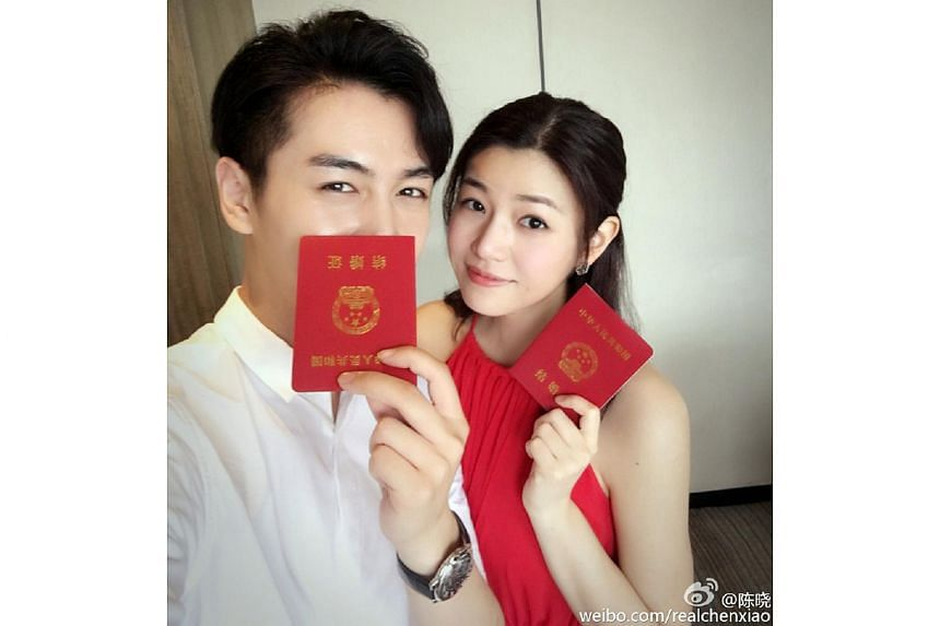 Michelle Chen and Chen Xiao obtaining their marriage certificates in China, on July 5, 2016.