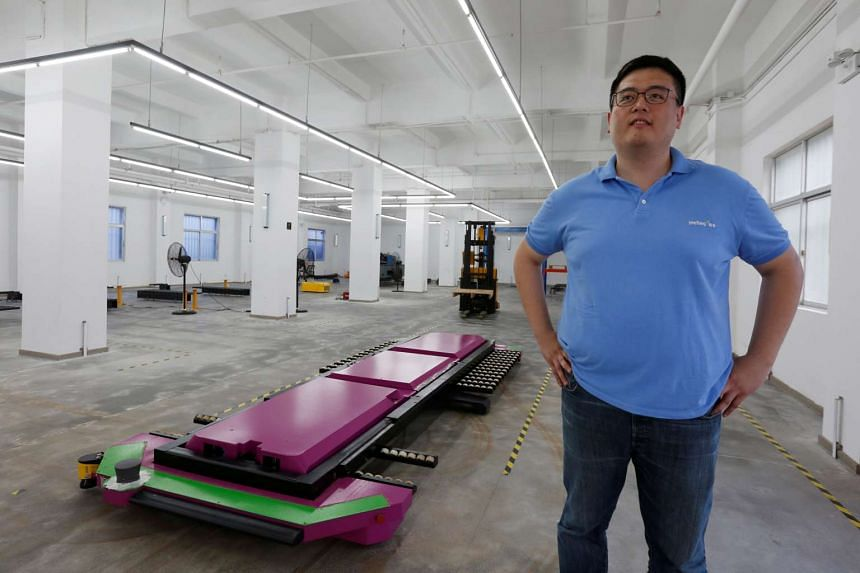 Yee Fung Automation Technology CEO Marco Wu with his Geta robot, which helps to park cars.