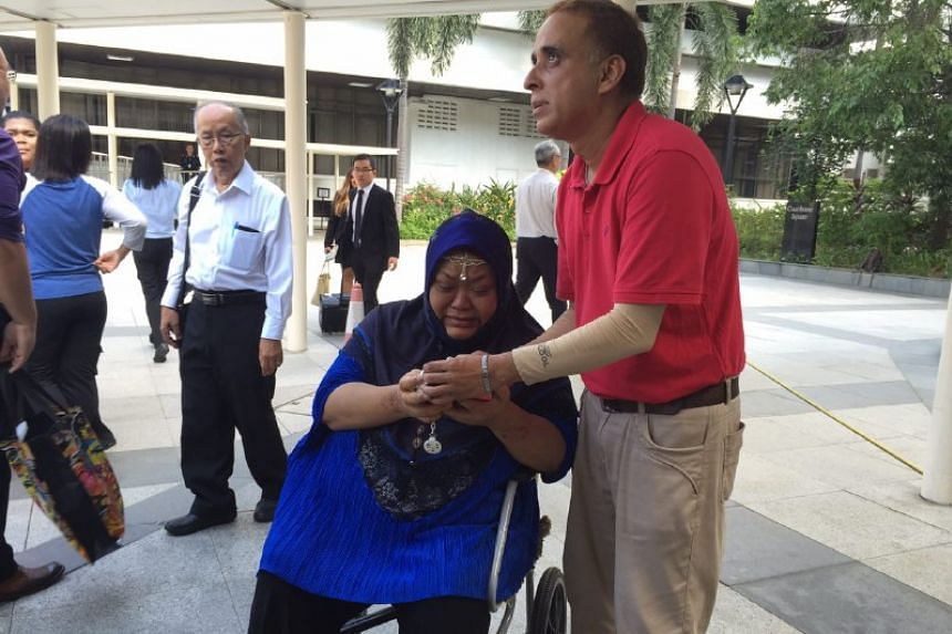 Daniel's caretaker, Madam Masita Hussin, with his father Mr Mohamad Nasser outside the State Courts after the sentencing.