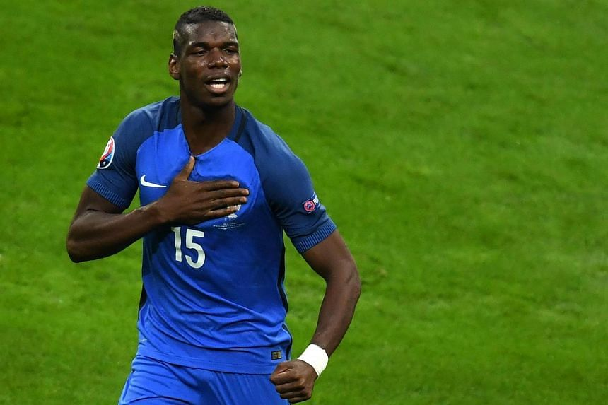 Paul Pogba celebrates after scoring his team's second goal during the Euro 2016 quarter-final football match between France and Iceland.