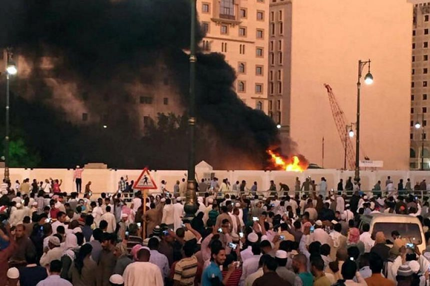 Muslim worshippers gather after a suicide bomb attack near the Prophet's Mosque in Medina, Saudi Arabia.