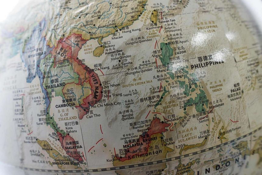 The South China Sea is seen on a globe on sale at a bookstore in Beijing on June 15.