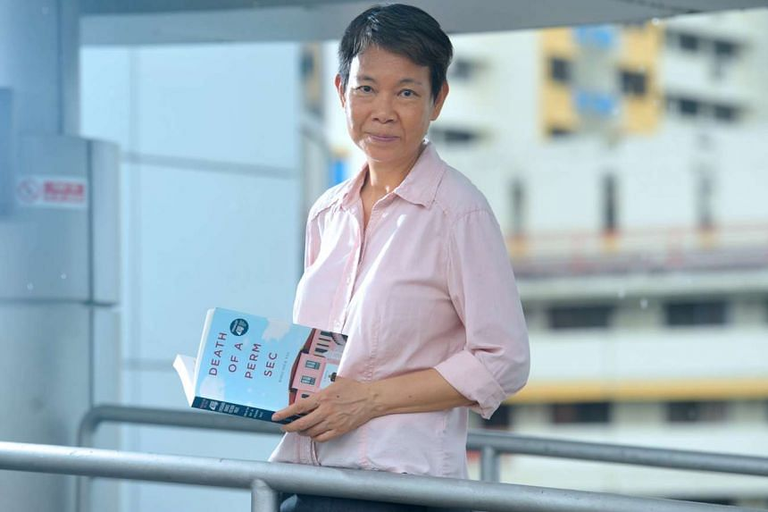 Wong Souk Yee (above) with her book, Death Of A Perm Sec, about the death of a permanent secretary at the housing ministry who is accused of corruption, and the blow it deals to his family.