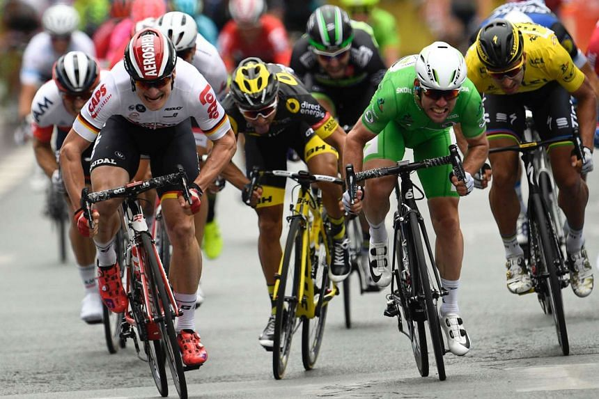 Britain's Mark Cavendish (second from right) crosses the finish line ahead of Germany's Andre Greipel (left), France's Bryan Coquard (second from left) and Slovakia's Peter Sagan (right) at the end of the 223,5 km third stage of the 103rd edition of