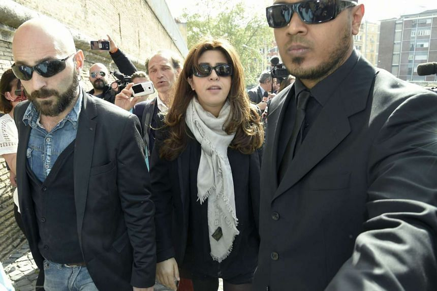 """Francesca Chaouqui (centre), an Italian PR consultant accused of leaking classified documents to journalists, arrives at the Vatican for a hearing of the """"Vatileaks"""" trial. She is accused of conspiring with Spanish Monsignor Lucio Vallejo Balda and h"""