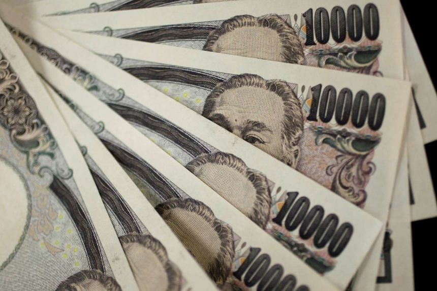 A picture illustration shows Japanese 10,000 yen notes.