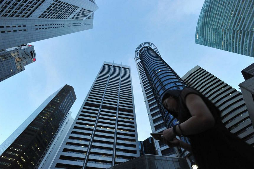 Operating conditions for Singapore firms picked up slightly last month as output and new orders rose, according to a new survey.