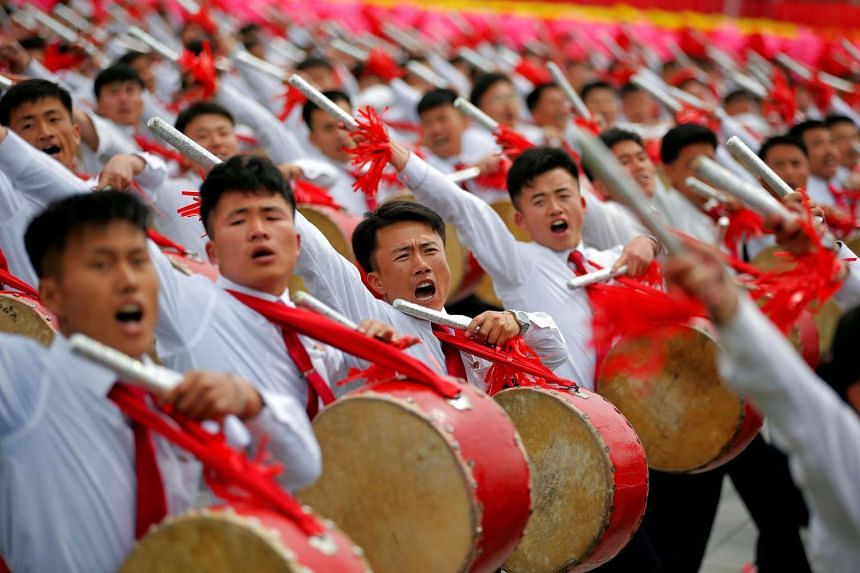 Participants react as they see North Korean leader Kim Jong Un during a mass rally and parade in the capital's main ceremonial square.
