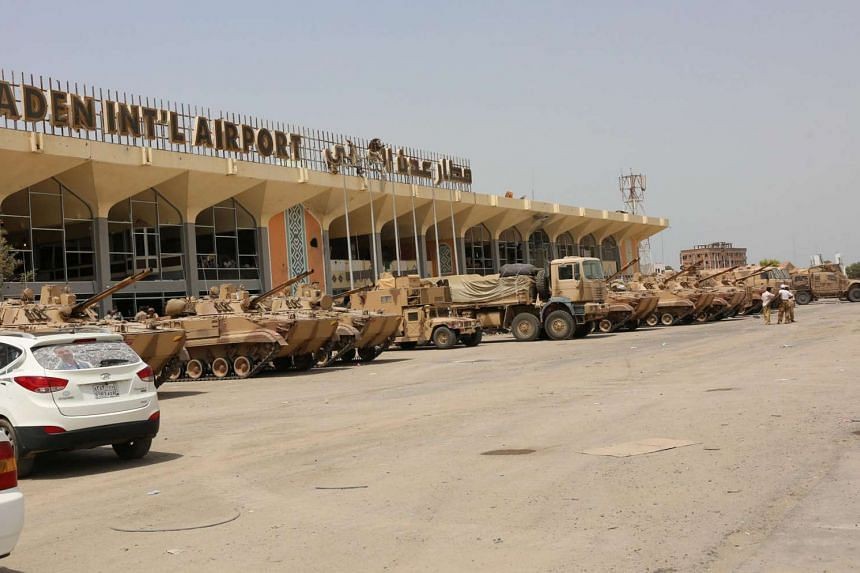 UAE military vehicles are seen at the international airport of the southern port city of Aden, Yemen.
