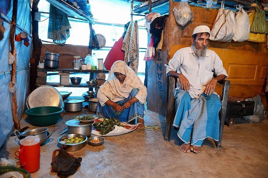 Rohingya Muslim Mohammed Noor and his wife in their tent in a refugee camp in Telangana, south India. More than 1,200 Rohingya fleeing sectarian violence in Myanmar have settled there.